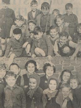 Children watching Guy Fawkes procession, 1947, from Priaulx Library Collection
