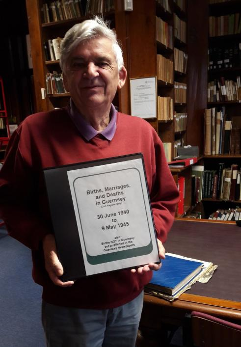 Priaulx Library customer and local history researcher Arthur Le Page with the Occupation BMD Indexes