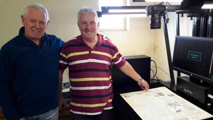 Volunteers Barry Gibson and Alan Solway using the large Metis scanner to digitise the newspaper collection