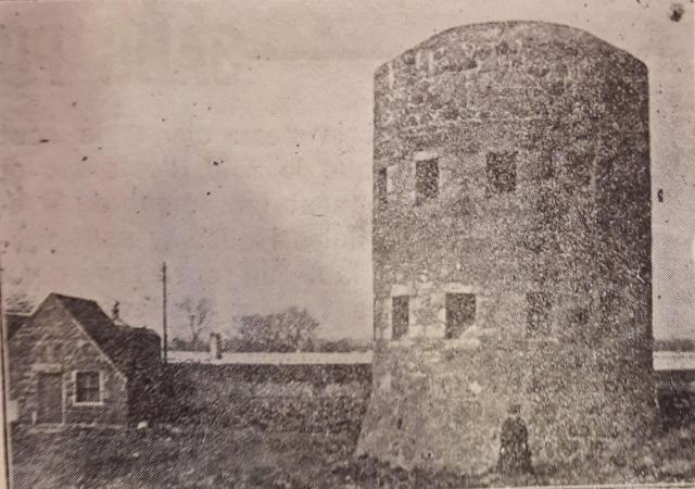 Mrs Curtin u=in front of Belle Greve tower